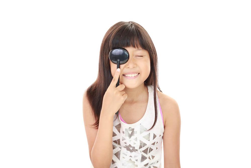 Girl taking an eye test